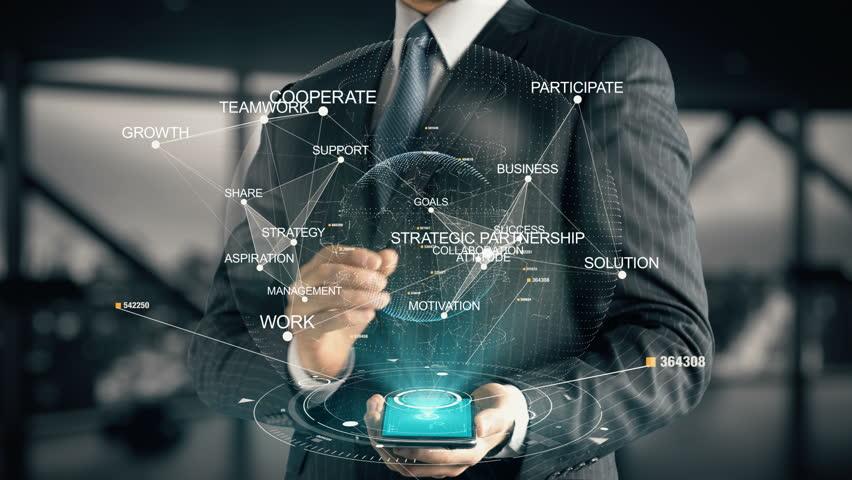 Businessman with Strategic Partnership hologram concept | Shutterstock HD Video #28335955