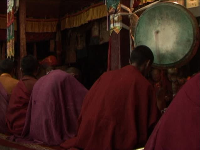Drummer monk in the buddhist monastery in Ladakh