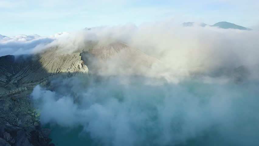 Flying on a Drone Above the Crater of the Ijen Volcano With an Acid Lake, Java, Indonesia | Shutterstock HD Video #28339981