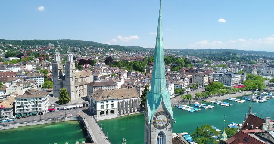 Flying over Zurich and the River Limmat on this beautiful summer day. You can see the famous churches, tourist boats and the city life.