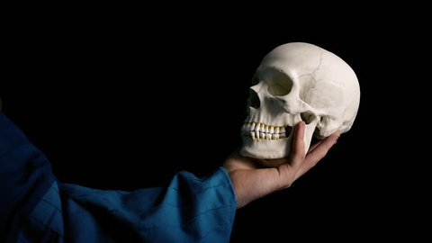 Skull Held Out - Theater Acting Concept