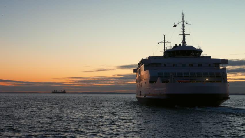 HELSINGBORG, SWEDEN - DECEMBER 12, 2016 Ferry boat departing from Helsingborg, Sweden harbor at dusk