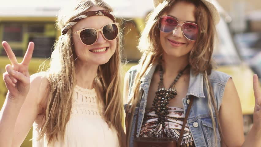 Close-up portrait of two hippy girl clothes. Young women in the style of a boho