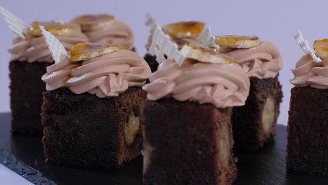 Chocolate muffin with small pieces of mango. Chocolate cupcakes with mango