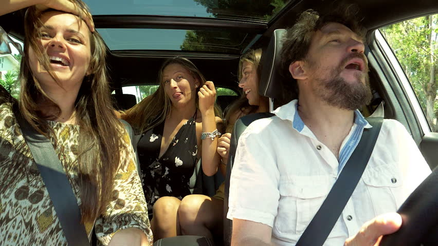 Super cool family dancing in car happy funny #28451509