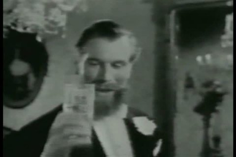 1950s: A television commercial for Schweppes club soda features socialites flirting at a fancy party, in the 1950s.