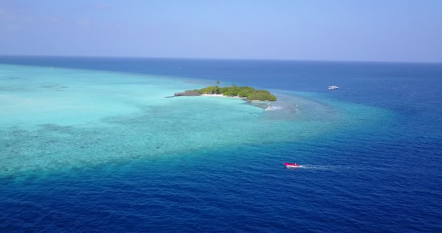 V05339 Aerial flying drone view of Maldives white sandy beach on sunny tropical paradise island with aqua blue sky sea water ocean 4k   Shutterstock HD Video #28512409