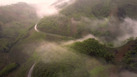 Aerial over a mountain road in Mu Cang Chai, Vietnam at clouds altitude