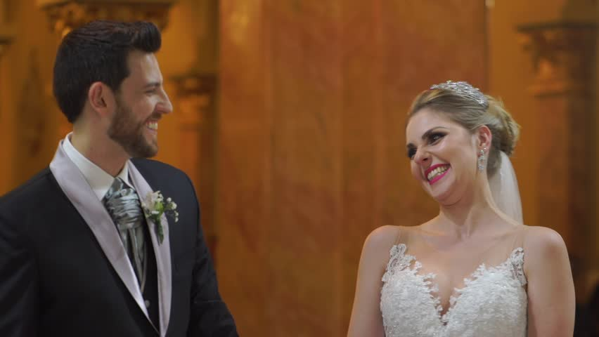 Groom And Bride Celebrating The Wedding Ceremony In Church