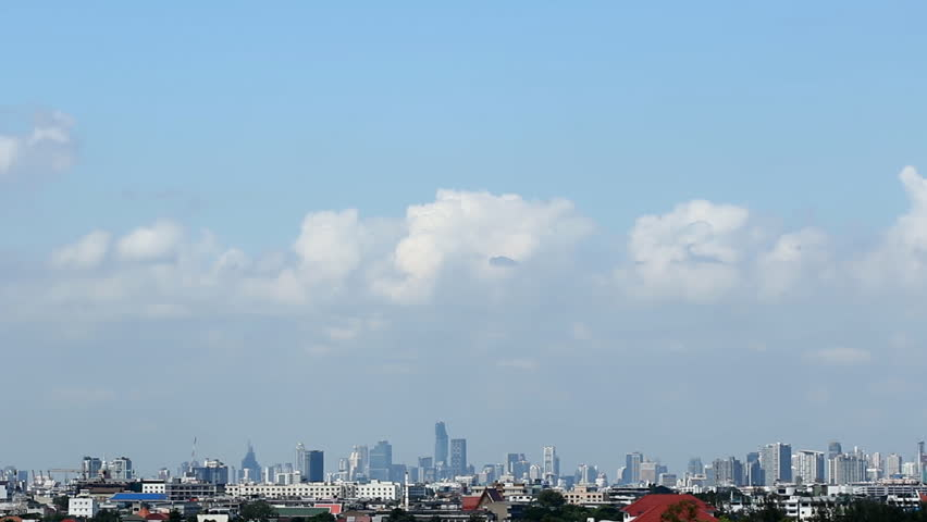 Time Lapse, Clouds changes on the Sky  over  skyscrapers city in Bangkok ,With Slow motion