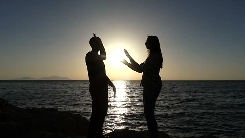 Image of: Comedy Funny View On Young Man And Young Woman Who Play Criss Cross High Five On Picturesque Seashore At Sunset In Slow Motion They Are In Love And Feel Happy Funny View On Young Stock Footage Video 100 Royaltyfree