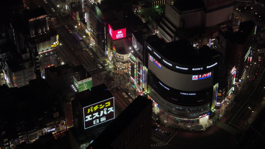 Japan Tokyo Aerial v80 Birdseye view flying low around famous Shinjuku crossing night 2/17