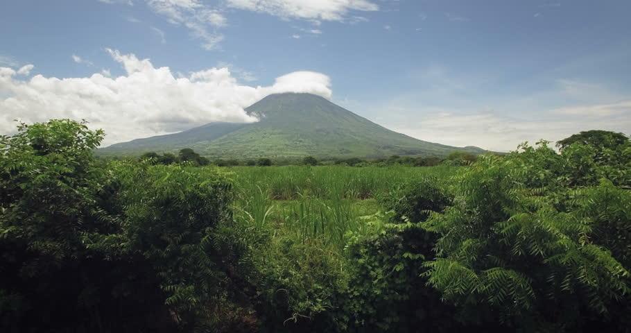 An aerial view of sugar cane plantations surrounding of the Chaparrastique Volcano in San Miguel, El Salvador.