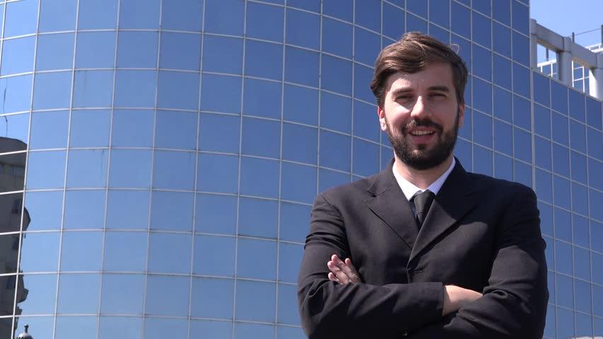 Handsome urban Caucasian business man outdoor smiling  | Shutterstock HD Video #28671649