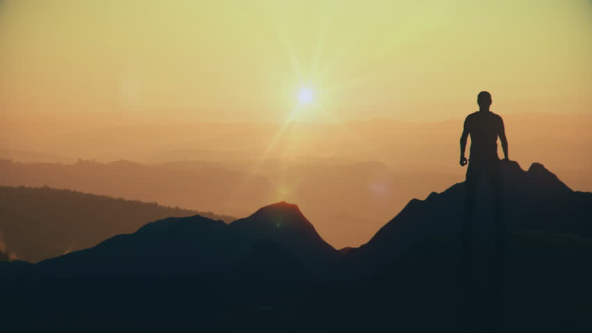 Animated CGI silhouette in a victory pose on the peak of a mountain. 4K animation. | Shutterstock HD Video #28699483