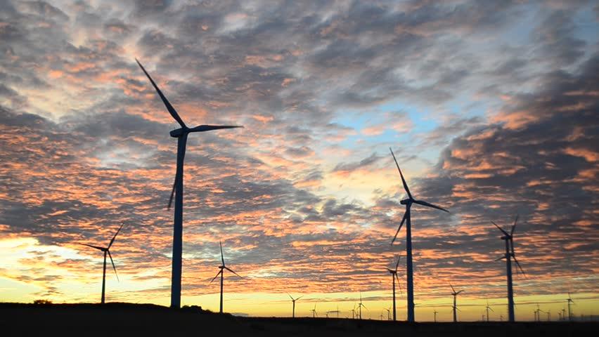 Wind turbines at sunset