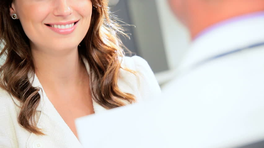 Male medical doctor in consulting rooms with young female patient