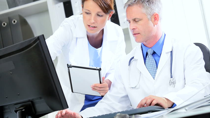 Hospital consultants using wireless tablet check patients test results