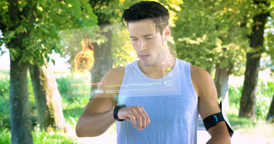 A futuristic young athlete (guy) uses a holographic hologram, looks at the heartbeat, pulse, cardio, runs on the street. Concept: future, new system, love sports, health, people, a sensational screen.