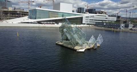 Oslo Norway aerial reveal of city skyline from glass sculpture opera