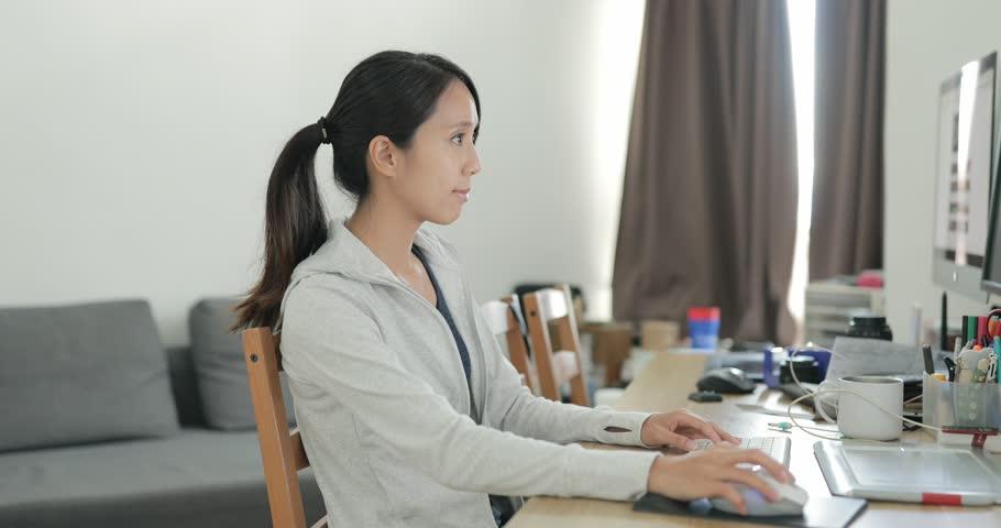 Woman working at homeWoman in Tai O village in Hong Kong