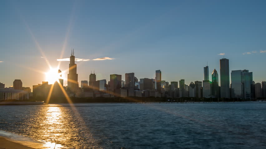 Beautiful Sunset in Chicago through buildings 4K 1080P - Sun setting in Chicago on Lake michigan time lapse of downtown