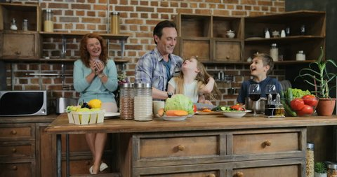 Family Cooking Together Using Recipe Stock Footage Video