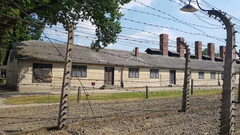 POV of barbed wire fences. Auschwitz Birkenau camp, German Nazi concentration camp. About 1.3M people were sent in the other side of the fences, of whom at least 1.1M died. 90% of killed were Jewish