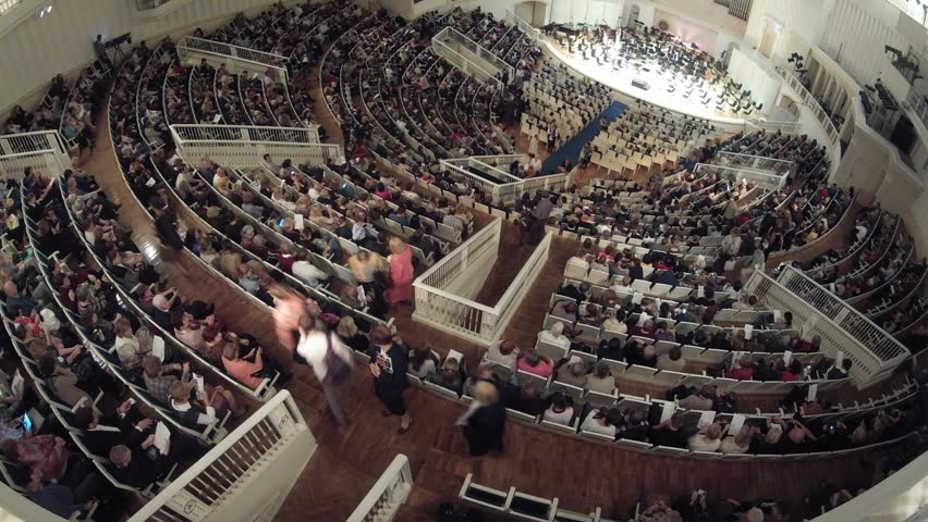 People listen to concert of classical music, time lapse