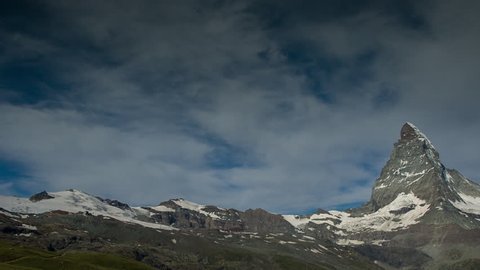 the amazing matterhorn and surrounding mountains in the Swiss Alps with fantastic cloud formations
