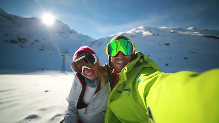 Couple taking selfie on ski slope Young couple takes selfie on ski slopes, Swiss Alps #28868209