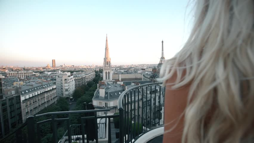 Girl enjoys sunset on the balcony in Paris | Shutterstock HD Video #28870099