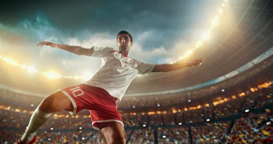 4k footage of a soccer player in dramatic play during a soccer game on a professional outdoor soccer stadium. Player wears unbranded uniform. Stadium and crowd are made in 3D.