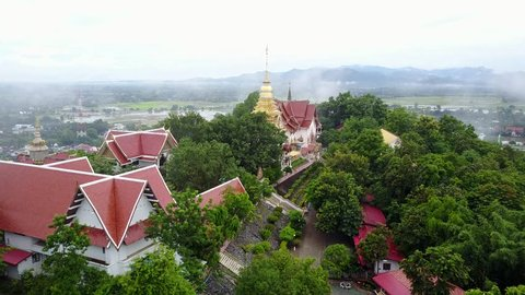 Aerial view, Wat Phra That Doi Saket temple and fog movement on the mountain in Chiang mai, Thailand.