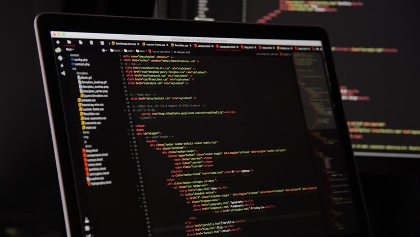 HTML and CSS code developing. Website design code programming on a laptop screen.  | Shutterstock HD Video #28903939