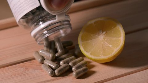 Lemon and pills. Sport supplement, creatine, hmb, bcaa, amino acid or vitamin. Sport nutrition and health