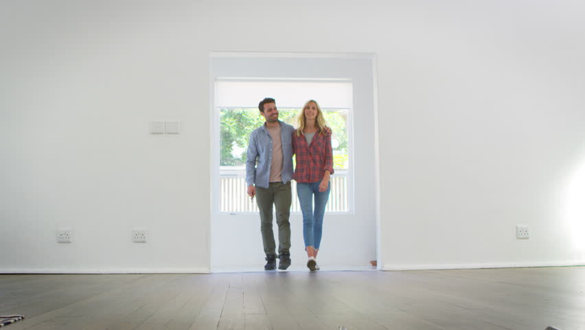 Excited Young Couple Moving Into New Home Together | Shutterstock HD Video #28931059