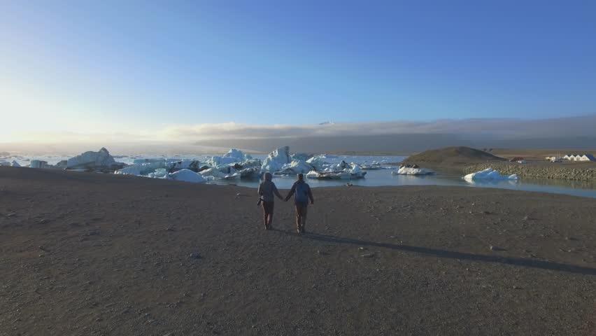 Woman explorer walking at Jokulsarlon lagoon, Iceland | Shutterstock HD Video #28932229