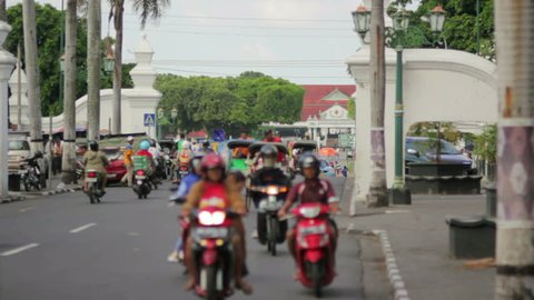 various mopeds and rickshaws in Indonesia