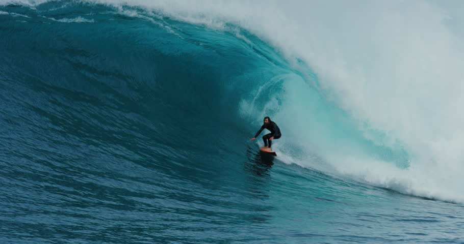 AUSTRALIA. June, 14 2017: Surfer rides perfect blue giant ocean wave barrel. Shot on RED in 4k. EDITORIAL USE