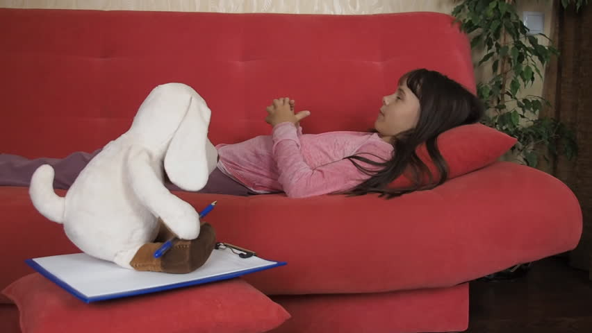 A child plays in a psychologist. Little girl with a soft toy talking. | Shutterstock HD Video #28962019