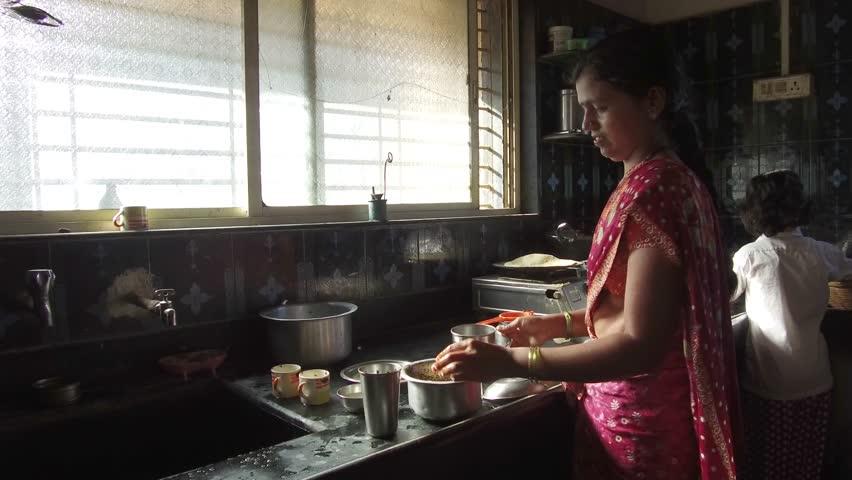 Lady cooking in the kitchen rural village Salunkwadi, Ambajogai, Beed, Maharashtra, India, Southeast Asia