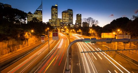 Timelapse footage a busy road turning from day to night at rush hour in Sydney, Australia