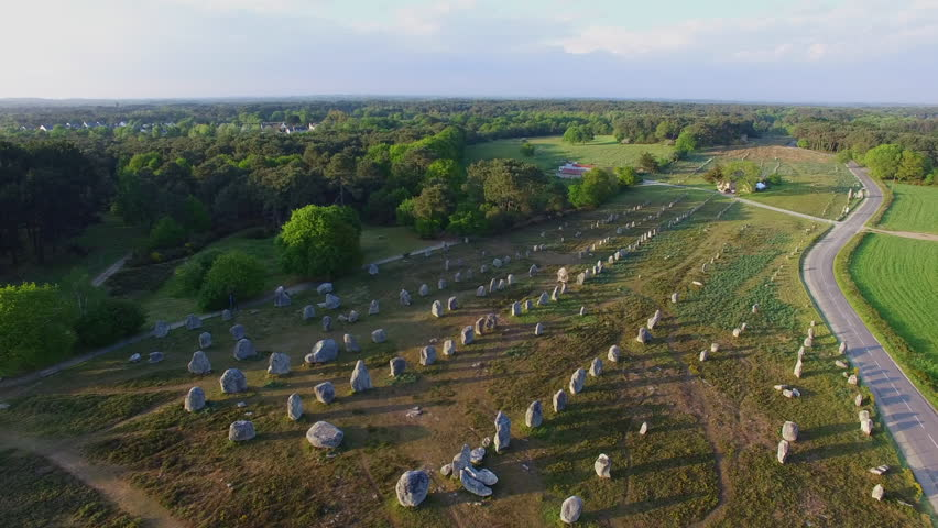 "Flying over the famous ""Alignements de Carnac"" located in Carnac, Morbihan, Brittany, France. Sunset on the Megaliths of Kermario, one of the largest Megalithic complex in the world."