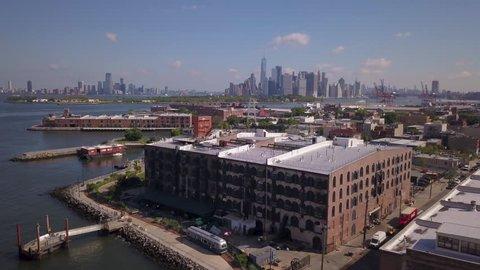 day orbiting clockwise around Red Hook Brooklyn warehouse with Manhattan skyline in BG