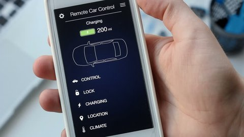 Man checks charge level of his electric car. Battery is charged. Car remote control using smartphone application fictional interface.