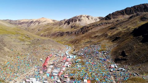 Aerial video footage of the Snow Star Festival (Quyllurit'i) in the Andes of Peru in 4800 m altitude. The bigest andean folk festival with thousands of people. Here filmed in June 2017. 4K resolution.