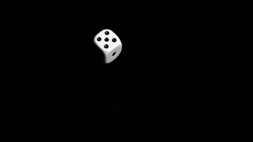 One white dices in super slow motion rebonding against a black background