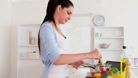 Woman is cooking in the kitchen