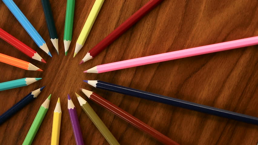 A lot of multicolored pencils revolve in a circle on a black wooden background. Concept office or school, knowledge day, the first of September. Video footage is spinning | Shutterstock HD Video #29052259